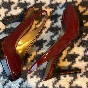 Scarlet patent tortoise heel